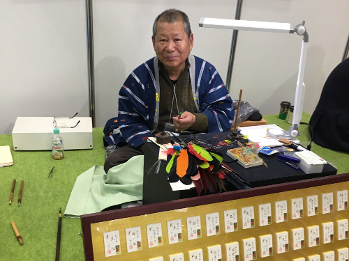 Kazutsugu Fujiwara tying Banshu Kebari, used for Ayu fishing