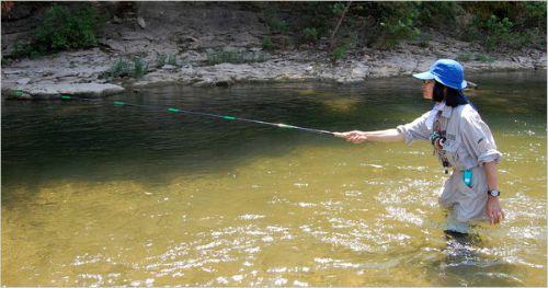Slide: Photo of Misako Ishimura fishing with her rod nearly horizontal.
