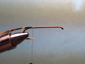 Hook in vise with thread base and tinsel tied in.