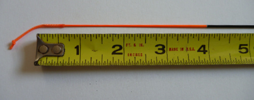 Rod tip showing lillian, with ruler for scale. The last four inches of the rod is painted orange.