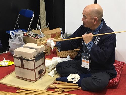 Yasuo Nakadai straightening bamboo.