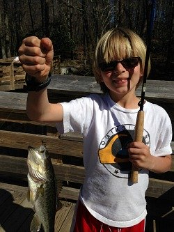 Young angler with largemouth bass