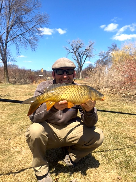 AAron B holding carp he caught with Flying Dragon