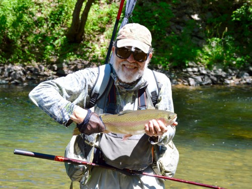 Angler holding a nice rainbow trout