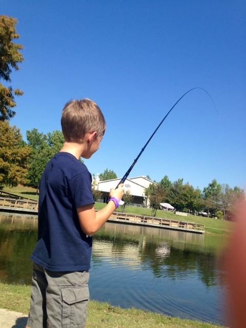 Child fishing in lake.