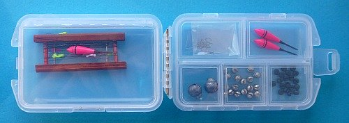 Tanago Tackle Box holding floats, weights, hooks, etc.
